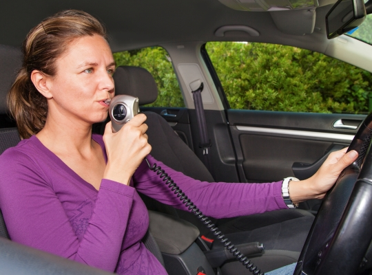 Lady with the breathalyzers in a car