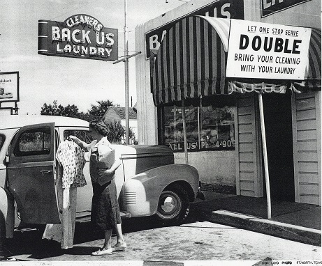 Katherine Backus Durbin in front of Back Us Laundry, undated