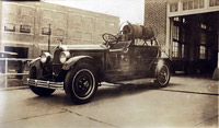 Fire Department truck in front of Fire Station, no date, station not identified