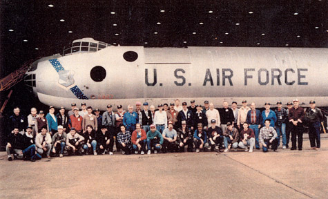 USAF airplane with large group of people posing in front of it