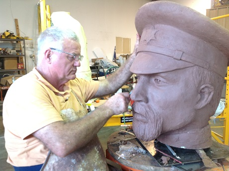 Archie St. Clair sculpting Major Ripley Arnold's head