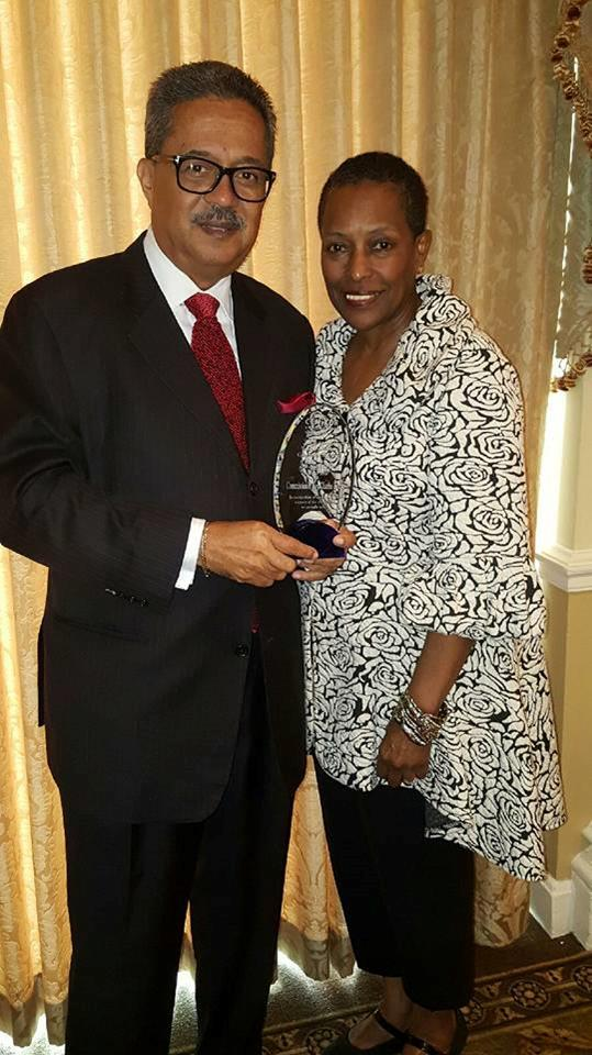 Commissioner and Dr. Brooks posing with award