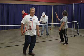 Senior Citizens playing tennis