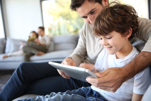 Dad and son looking at a tablet