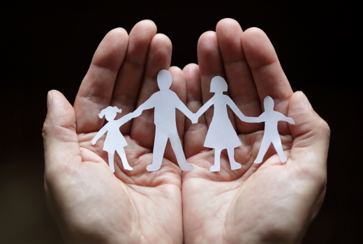Hands with family paper cut out