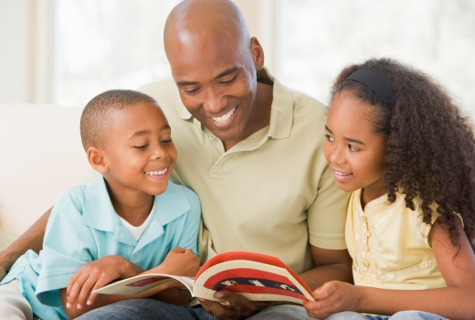 Dad reading with kids
