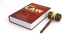 law book with red cover and gavel