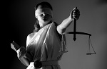 woman as blindfolded justice holding scales