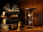 hourglass, gavel, and old books
