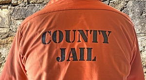 Man wearing County Jail shirt