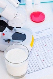 Glass of milk and laboratory equipment