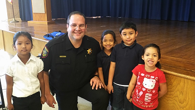 Community Relations Sergeant with students