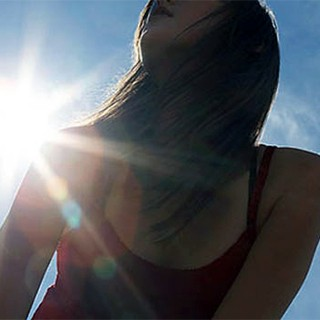 bright sun shining on young woman