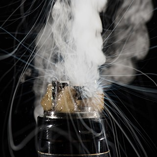 e-cigarette battery smoking and bubbling