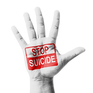 Open hand raised, Stop Suicide sign painted, multi purpose concept - isolated on white background