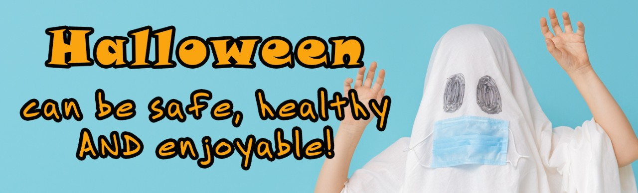 Halloween Can be safe, healthy AND enjoyable (boy wearing sheet appearing as ghost with drawn on eyes and attached COVID-19 protective mask
