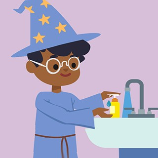 boy in wizard costume washing his hands