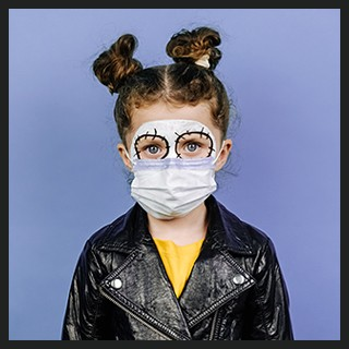 Girl with painted face, protective mask