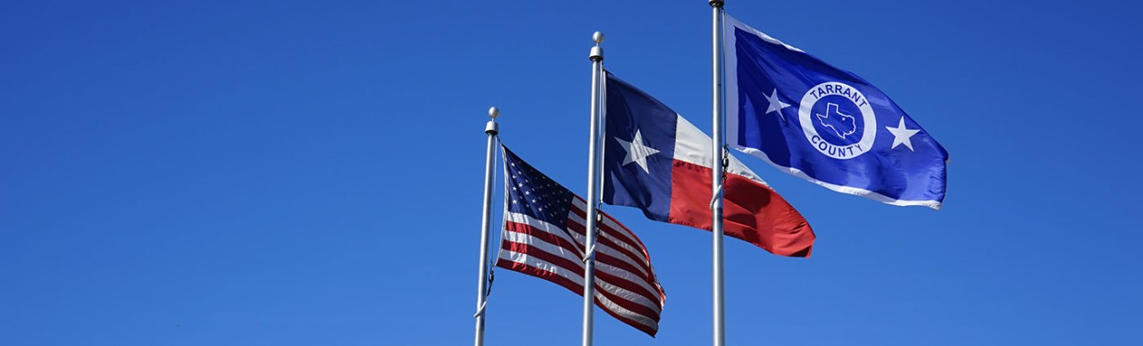 US, Texas, and Tarrant County flags