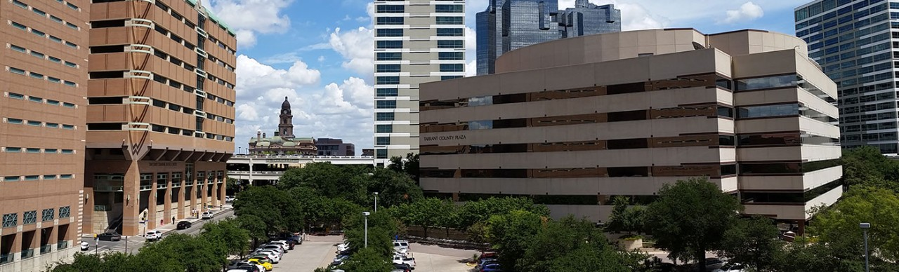Panorama view of the Tarrant County Plaza Building with the 1895 Courthouse in the background